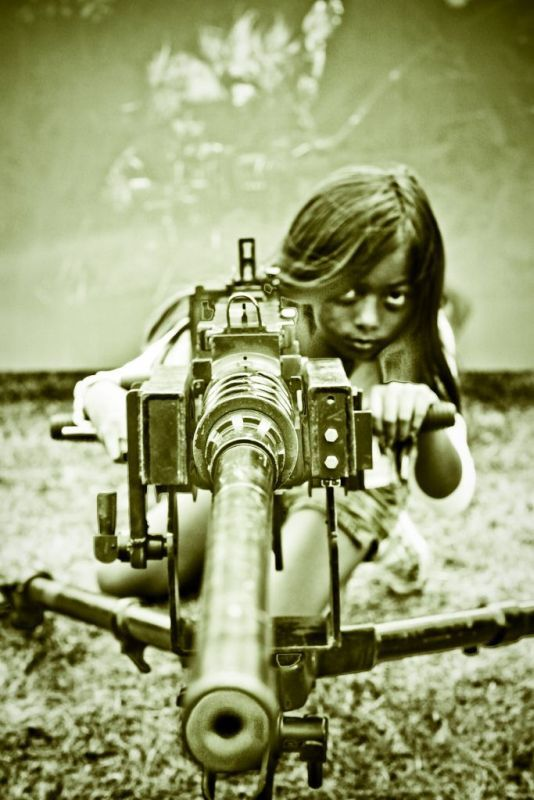 Little girl with machinegun